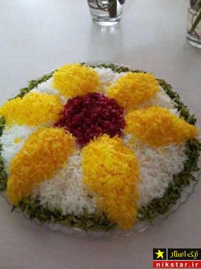 تزیین دیس برنج با زرشک و زعفران به شکل گل