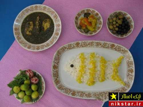 تصویر تزیین برنج با زعفران به شکل ماهی
