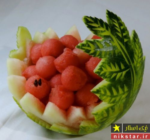 تزیین هندوانه شب یلدا به شکل سبد جا میوه ای